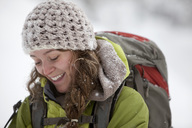 A young woman hikes with a backpack in fresh powder in the Wasatch Mountains, Utah. - AURF00690