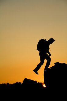 Man hikes in California foothills. - AURF00864