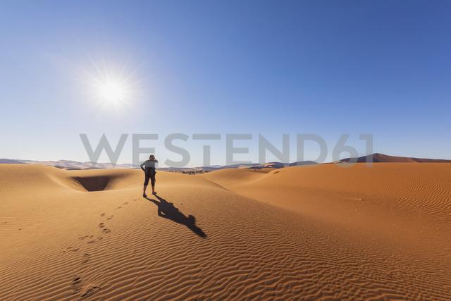 Africa, Namibia, Namib desert, Naukluft National Park, female tourist walking on dune - FOF10069