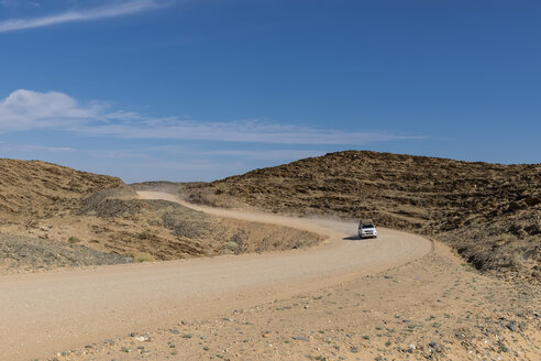Africa, Namibia, Namib desert, Naukluft National Park, off-road vehicle on gravel road - FOF10072