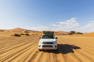 Africa, Namibia, Namib desert, Naukluft National Park, off-road vehicle on sand track - FOF10075