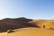 Africa, Namibia, Namib desert, Naukluft National Park, female tourist walking on dune - FOF10078