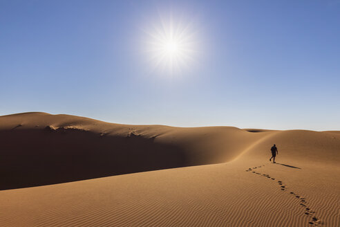 Africa, Namibia, Namib desert, Naukluft National Park, tourist walking on dune - FOF10081