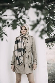 Portrait of fashionable young woman wearing coat and scarf - JESF00079
