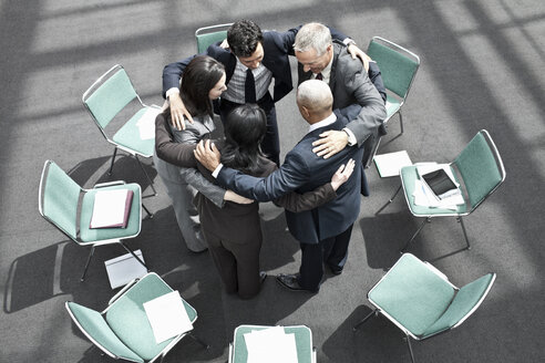 Mixed race group of business people in an informal team building meeting. - MINF08943