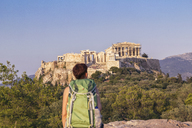 Greece, Athens, Tourist looking to the Acropolis from Pnyx - MAMF00214