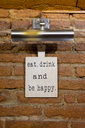 Board with a saying on brick wall in a restaurant - AFVF01453
