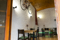Interior of a restaurant with bicycle hanging on the wall - AFVF01474