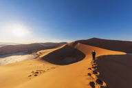 Africa, Namibia, Namib desert, Naukluft National Park, woman on sand dune 'Big Daddy' - FOF10087