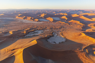 Africa, Namibia, Namib desert, Namib-Naukluft National Park, Aerial view of desert dunes, Nara Vlei and Sossus Vlei and 'Big Mama', Dead Vlei and 'Big Daddy' in the morning light - FOF10117