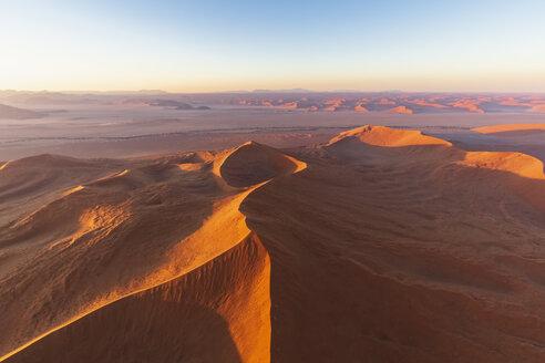 Africa, Namibia, Namib desert, Namib-Naukluft National Park, Aerial view of desert dunes in the morning light - FOF10126