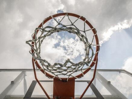Basketball hoop against clouded sky - JMF00419