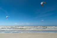 Germany, Schleswig-Holstein, Sankt Peter-Ording, kitesurfers in the North Sea - UM00848
