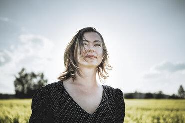 Portrait of woman in rape field - PSIF00023