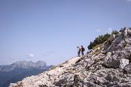 Austria, Salzburg State, Loferer Steinberge, brother and sister on a hiking trip in the mountains - HAMF00353