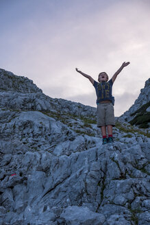 Austria, Salzburg State, Loferer Steinberge, boy on a hiking trip cheering in the mountains - HAMF00362