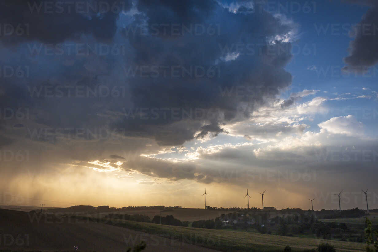 Germany, Lausitz, wind wheels and  thundercloud - HAMF00366 - Hans Mitterer/Westend61