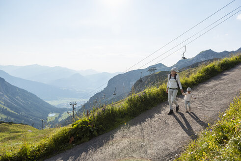 Germany, Bavaria, Oberstdorf, mother and little daughter on a hiking trip in the mountains - DIGF04969
