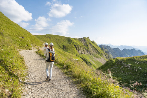 Germany, Bavaria, Oberstdorf, mother and little daughter on a hiking trip in the mountains - DIGF04972