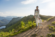 Germany, Bavaria, Oberstdorf, mother and little daughter on a hiking trip in the mountains - DIGF04981