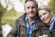 Portrait happy, affectionate mature couple - HOXF03713