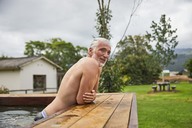 Mature man relaxing in hot tub - CAIF21340