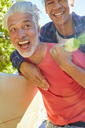 Playful father and son piggybacking - CAIF21376