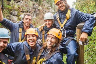 Portrait smiling, confident friends zip lining - CAIF21400