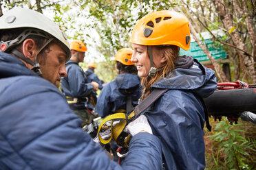 Friends preparing zip line equipment - CAIF21433