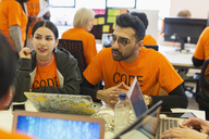 Hackers coding for charity at hackathon - CAIF21481
