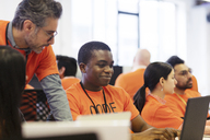 Hackers at laptops coding for charity at hackathon - CAIF21514