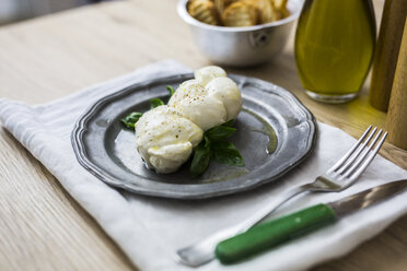 Mozzarella braid and basil on plate - GIOF04237