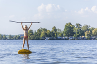 Young girl stand up paddle surfing - TCF05662