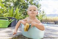 Boy sitting in baby bathtub - TCF05671