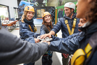 Friends in a huddle preparing to zip line - CAIF21730