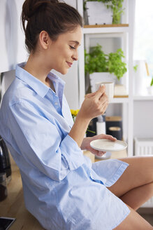 Young woman at home in kitchen, - ABIF00906