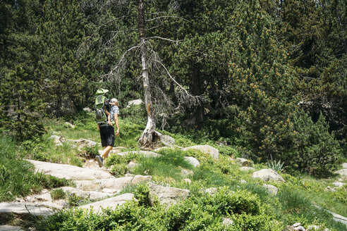 Spain, Father hiking in the mountains with little daughter, sitting in carrying frame - GEMF02338