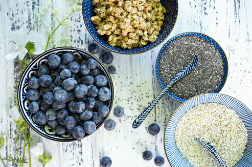 Bowls of granola, blueberries, black chia seeds and amaranth - ASF06214
