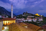 Albania, Kruje, townscape with bazaar street, Bazaar Mosque, Skanderbeg Museum and fortress in the evening - SIEF07923