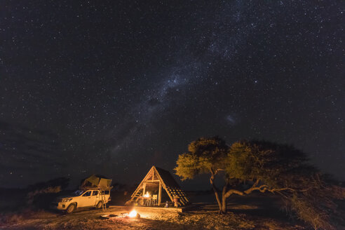 Africa, Botswana, Kgalagadi Transfrontier Park, Mabuasehube Game Reserve, Camping ground under starry sky - FOF10211
