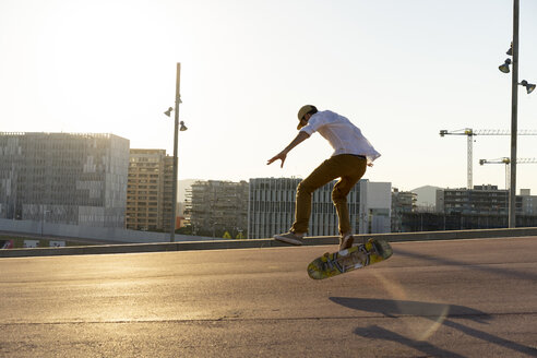 Young man riding skateboard in the city - AFVF01479