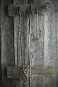 Old ski poles hanging on rustic wooden wall - ASF06220