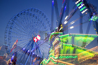 Germany, Wuerzburg, Kiliani Fair in the evening, blurred motion - NDF00787