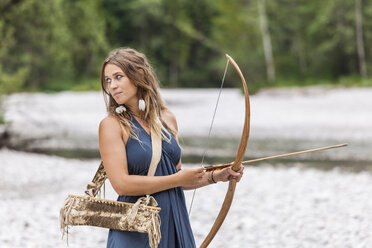 Archeress with bow and arrow in the nature - TCF05778