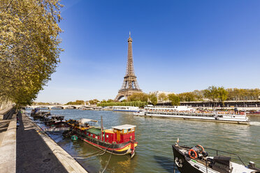 France, Paris, Eiffel Tower and tour boat on Seine river - WDF04794