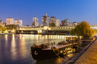 France, Paris, Pont de Bir-Hakeim, Seine river, modern high-rise buildings at blue hour - WDF04803