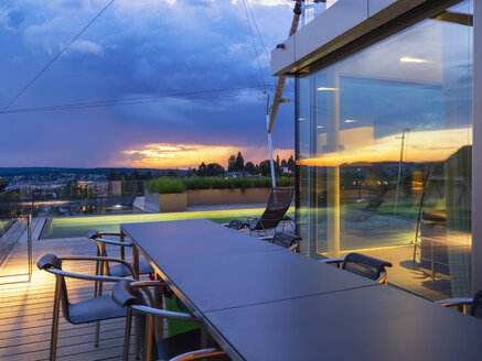 Switzerland, view from terrace of  modern villa at sunset - LAF02081