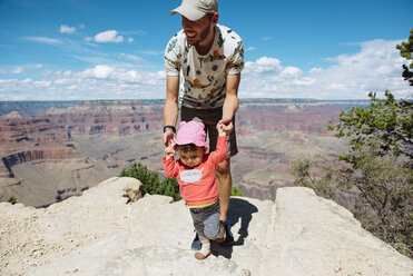 USA, Arizona, Grand Canyon National Park, father and baby girl  on viewpoint, girl learning to walk - GEMF02360