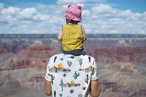 USA, Arizona, Grand Canyon National Park, father and baby girl enjoying the view, rear view - GEMF02369