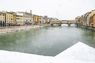 Italy, Florence, view to Ponte Vecchio on a snowy day - MGIF00219